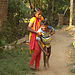 Nagaraju walking with the help of his sister