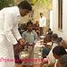 Pastor Rao serving food